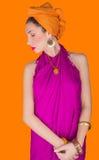Härlig flicka i en färgklänning Arkivbilder