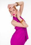 Härlig flicka i en färgklänning Royaltyfri Fotografi