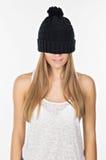 Härlig flicka i en hatt Royaltyfri Fotografi