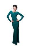 Härlig flicka i en lång turkosklänning Royaltyfria Bilder