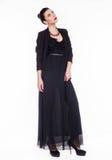 Härlig flicka i en svart klänning Royaltyfria Foton