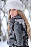 Härlig flicka i furry hatt royaltyfri bild