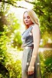 Härlig flicka i grön magisk skog royaltyfria foton