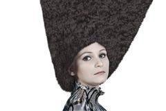 Härlig flicka i hatten Royaltyfria Foton