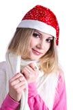 Härlig flicka i hatten av Santa Claus Royaltyfri Foto