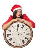 Härlig flicka i a i jultomten en hjälpredahatt som rymmer en stor tappning w Fotografering för Bildbyråer
