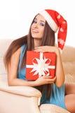 Härlig flicka i julhatt Arkivfoto
