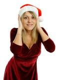 Härlig flicka i jultomtenhatt Arkivbilder
