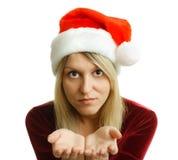 Härlig flicka i jultomtenhatt Arkivbild