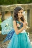 Härlig flicka i klänning med vingar Arkivbilder