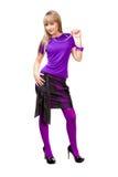 Härlig flicka i purpur kläder Arkivfoto