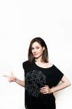 Härlig flicka i svart klänning arkivfoto