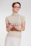 Härlig flicka med böcker och bärande exponeringsglas Arkivbild