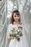 Härlig flicka med blommor Arkivfoton