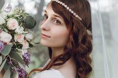 Härlig flicka med blommor Fotografering för Bildbyråer