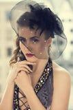 Härlig flicka med den gulliga hatten Royaltyfri Foto