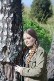 Härlig flicka med den långa flätad tråden Fotografering för Bildbyråer