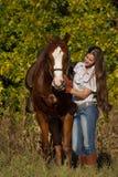 Härlig flicka med en häst Arkivbild