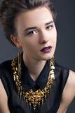 Härlig flicka med halsbandet royaltyfria foton