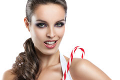 Härlig flicka med julgodisen Royaltyfri Bild