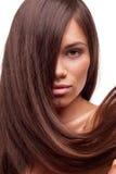 Härlig flicka med långt hår Arkivfoton