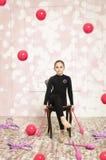Härlig flicka med rosa hjälpmedel för rytmisk gymnastik Royaltyfri Foto