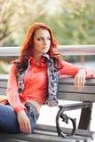 Härlig flicka på bänken Fotografering för Bildbyråer