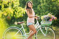 Härlig flicka på cykeln royaltyfri fotografi