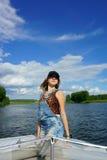 Härlig flicka på en yacht Arkivfoton