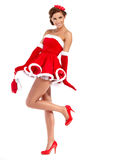 Härlig flicka som bär Santa Claus kläder Fotografering för Bildbyråer