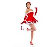 Härlig flicka som bär Santa Claus kläder Royaltyfri Bild