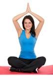 Härlig flicka som gör yoga Arkivfoton