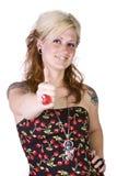 härlig flicka som ger upp tum Royaltyfria Foton