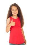 härlig flicka som ger upp tumen Arkivbilder