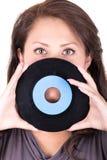 Härlig flicka som rymmer en vinyl - på vit Royaltyfria Bilder