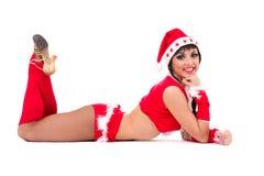 Härlig flicka som slitage Santa Claus kläder Fotografering för Bildbyråer