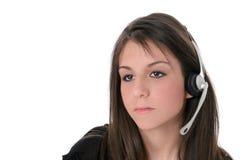 härlig flickahörlurar med mikrofon över teen white Royaltyfri Foto