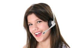 härlig flickahörlurar med mikrofon över teen white Arkivfoto