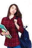 Härlig flickaskolflicka, student med läroböcker och ryggsäck Royaltyfri Bild