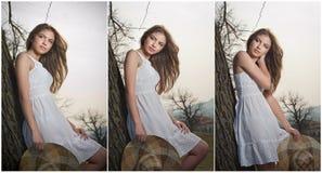 Härlig flickastående med hatten nära ett träd i trädgården. Ung Caucasian sinnlig kvinna i ett romantiskt landskap. Girt i vit Fotografering för Bildbyråer