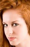 härlig flickaståenderedhead Fotografering för Bildbyråer
