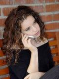 härlig flickatelefon royaltyfri bild