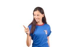 Härlig fransk flicka som pekar till sidan Arkivbild