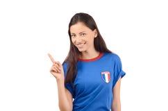 Härlig fransk flicka som pekar upp Arkivbilder