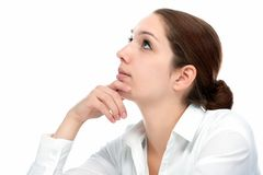 Härlig fundersam kvinna som ser upp Fotografering för Bildbyråer
