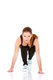 härlig görande övningskondition som sträcker kvinnan Royaltyfria Foton