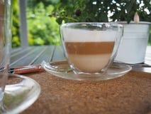 Härlig genomskinlig kopp kaffe arkivbild