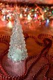Härlig glass julgran på en bakgrund av ljus Royaltyfri Foto
