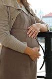 Härlig gravid kvinnamage Arkivfoto