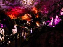 Härlig grotta med kulör belysning fotografering för bildbyråer